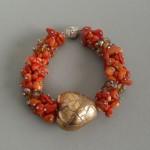 Pomarańczowo-czerwona ze złotą truskawką